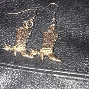 Pierced cowboy boot earrings.